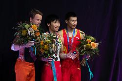 MELBOURNE, Feb. 24, 2019  Japan's Hidetaka Miyachi (C) of Japan and China's Zhang Chenglong (R) of China pose during men's high bar final at World Cup Gymnastics in Melbourne, Australia, on Feb. 24, 2019. Hidetaka Miyachi won the gold medal with a score of 14.733. Zhang Chenglong won the bronze medal with a score of 14.333. (Credit Image: © Eilzabeth Xue Bai/Xinhua via ZUMA Wire)