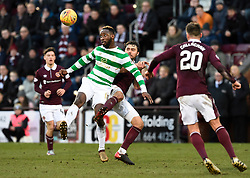 CelticÕs Moussa Dembele is tackled by Hearts Connor Randall with Ross Callachan looking on during the Ladbrokes Scottish Premiership match at Tynecastle Stadium, Edinburgh.