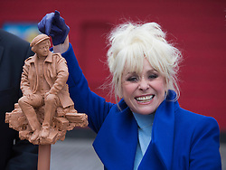 © Licensed to London News Pictures. 21/11/2013. London, England. Barbara Windsor has joined Theatre Royal Stratford East's fundraising campaign to build a sculpture for the legendary director Joan Littlewood with whom she worked during the early stages of her career. The theatre launches a public appeal to raise the final 40% needed (c. £60,000) to commission Philip Jackson to created the bronze sculpture which is due to be installed in Theatre Square, Stratford in spring 2014. Photo credit: Bettina Strenske/LNP