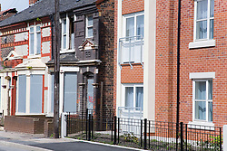New build property next to a row of houses ready for demolition in a designated area for the pathfinder regeneration scheme Bootle; Liverpool; England,