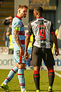 Martin Woods(C) of Dundee FC confronts Duckens Nazon of St Mirren during the Ladbrokes Scottish Premiership match between St Mirren and Dundee at the Paisley 2021 Stadium, St Mirren, Scotland on 30 March 2019.