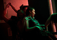 "Xavier Mascareñas/Treasure Coast Newspapers; Casey Cardinali (center), a 19-year-old of Port St. Lucie who was born with cerebral palsy, waits in the wings while harnessed to Tara Anstensen before they dance to ""I Believe"" during the Wings to Fly Dance Company dress rehearsal for their program ""Journey"" on Thursday, April 21, 2016, at the Lyric Theatre in Stuart. Amanda Irwin, of Palm City, stretching at left, said dancing with Cardinali is transformational. ""Before, in my career as a professional ballerina, it was about me and my lines,"" Irwin said. ""It's so cool because it's not about me, it's almost like I'm an extension of her when I dance,"" she added."