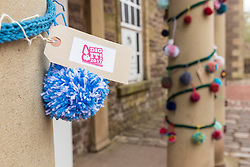 Yarn-bombing during the Scotland-wide World Heritage Day festivities. Six unique events, coordinated by Dig It! 2017, celebrated Scotland's six World Heritage Sites as part of the 2017 Year of History, Heritage and Archaeology. <br /> <br /> Pictured: Pom poms at the entrance to the New Lanark Institute