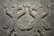 """Hittite relief sculpted orthostat stone panel of Herald's Wall Basalt, Karkamıs, (Kargamıs), Carchemish (Karkemish), 900-700 B.C. Bird-headed, winged figures of human body. Anatolian Civilisations Museum, Ankara, Turkey.<br /> <br /> These figures are called as """"Winged Griffin Demons"""". Embossing is constructed symmetrically. Their hands are on their heads. It is assumed that they carry the heavens. .<br />  <br /> If you prefer to buy from our ALAMY STOCK LIBRARY page at https://www.alamy.com/portfolio/paul-williams-funkystock/hittite-art-antiquities.html  - Type  Karkamıs in LOWER SEARCH WITHIN GALLERY box. Refine search by adding background colour, place, museum etc.<br /> <br /> Visit our HITTITE PHOTO COLLECTIONS for more photos to download or buy as wall art prints https://funkystock.photoshelter.com/gallery-collection/The-Hittites-Art-Artefacts-Antiquities-Historic-Sites-Pictures-Images-of/C0000NUBSMhSc3Oo"""