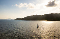 Aerial view of boat sailing along Sardinia coastal line, Italy.