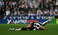 Photo: Andrew Unwin.<br /> Newcastle United v Fenerbahce. UEFA Cup. 19/10/2006.<br /> Newcastle's Antoine Sibierski cries out in pain as he lies injured.