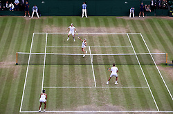 Martina Hingis and Jamie Murray (top of court) during the mixed doubles final against Heather Watson and Henri Kontinen on day thirteen of the Wimbledon Championships at The All England Lawn Tennis and Croquet Club, Wimbledon.