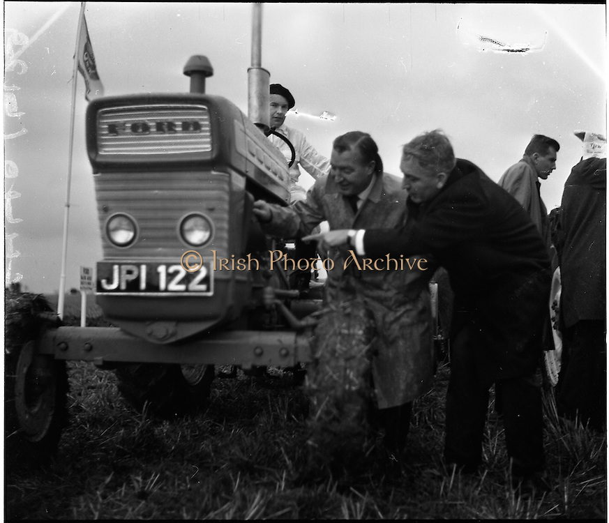 26/11/1964.11/26/1964.26 November 1964.Presentation of new Ford tractors at Lyons Estate Celbridge. Minister for Agriculture Charles Haugheyexamines one of the new Ford tractors with G.F. McGovern, Tractor Manager, Tractor Operations Henry Ford and Sons Ltd. Cork.