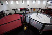 A cleaning crew works to clean the gym before practices and workouts start at Jackson Wink MMA in Albuquerque, New Mexico on June 9, 2016.