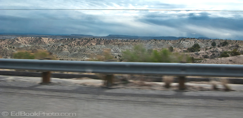 Northwestern New Mexico guardrail along a US highway separates the highway from the wild canyons.