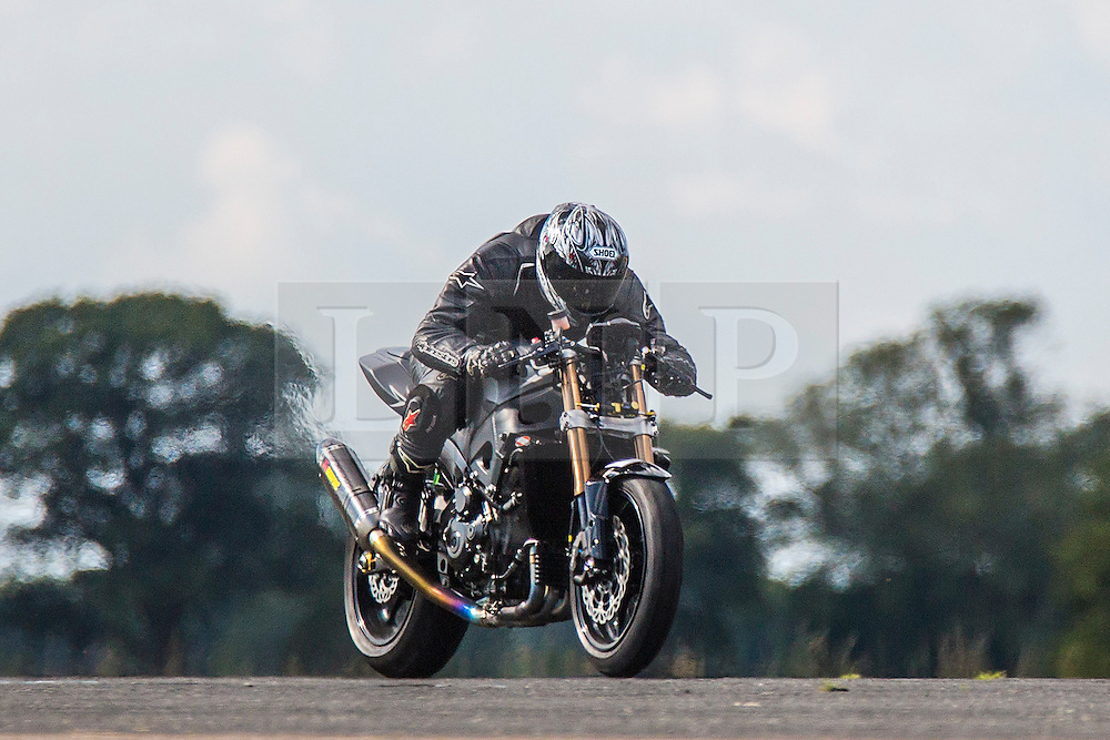 © Licensed to London News Pictures. 19/09/2015. York, UK. Picture shows a competitor at the Starightliners speed weekend that has taken place at Elvington Airfield near York today were a motorised shed, Jet car & motorbikes attempt new British speed records. Photo credit: Andrew McCaren/LNP
