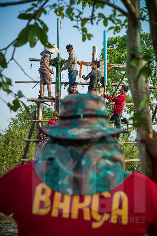 Contestants intall their rocket on the launching ramp during Boun Bang Fai, aka Rocket Festival, Ban Don Nieng, a small village near Vientiane, Laos, Southeast Asia