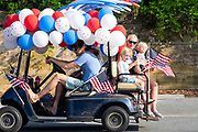 A golf cart float decorated in balloons and flags during the annual Independence Day parade July 4, 2019 in Sullivan's Island, South Carolina. The tiny Sea Island beach community across from Charleston, was once a quarantine station for enslaved Africans, and is now one of the most affluent, least diverse communities with one of highest per capita real estate costs in the United States.