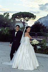 bride and groom laughing together on a patio in Italy