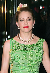 "Madonna ariving at the Empire Leicester Square for the British premiere of the film Evita. The American singer takes the lead role of Eva Peron in Alan Parker's film adaptation of the Lloyd Webber/Rice musical.   * 19/12/1996 of singer Madonna.  3/11/01: Queen of pop Madonna has taken Harry Potter author JK Rowling's crown as the country's highest earning woman, it was revealed. The Material Girl has qualified for the Sunday Times Pay List for the first time since marrying Guy Ritchie because the UK has become her main residence. In the past year she earned  30 million, compared with JK Rowling's  24.8m and the Queen's  15.2m income from the civil list and privy purse. Heading the top 500 once again is motor-racing supremo Bernie Ecclestone who raked in  788m which he primarily gained through selling a 25% share in Formula One racing.  This was up  171 million from his last year's earnings of  617 million which he gained after selling 50% of the company. Ecclestone still owns 25% of the business and will stay in charge until the end of the 2007 season.  *08/12/01 Pop superstar Madonna will tomorrow, Sunday 9th December 2001, add her razzmatazz to the UK art world's premier celebration as she hands over the Turner Prize. The chart queen - a keen art collector - will join artists and leading figures at the ceremony at the Tate Britain gallery in London.Installation artist Mike Nelson is the bookies' favourite to take the prize. The Turner was established in 1984 and offers a prize of  20,000 to an artist under 50 for an ""outstanding exhibition or other presentation of their work""."