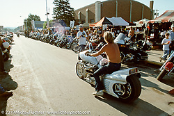 Arlen Ness riding his custom known as Ferrari Bike in bare metal down Main Street. Sturgis, SD. Photograph ©Michael Lichter 1988