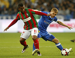 August 24, 2017 - Vitaliy Buyalskiy (R) of Dynamo vies for the ball with Éber Bessa (L)  of Maritimo  during the Europa League second play-off soccer match between FC Dynamo Kyiv and FC Maritimo, at the Olimpiyskyi stadium in Kyiv, Ukraine, August 24, 2017. (Credit Image: © Anatolii Stepanov via ZUMA Wire)