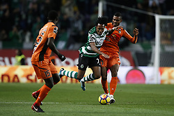 December 17, 2017 - Lisbon, Portugal - Sporting's forward Gelson Martins (C) vies for the ball with vies for the ball with Portimonense's midfielder Dener (R)  during Primeira Liga 2017/18 match between Sporting CP vs Portimonense SC, in Lisbon, on December 17, 2017. (Credit Image: © Carlos Palma/NurPhoto via ZUMA Press)