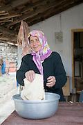 Turkey, Antalya, Koprulu River Canyon, The small village of Selge, Local woman preparing pita bread