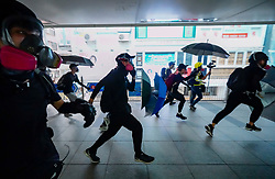 29th September 2019. Wanchai., Hong Kong. Pro democracy protestors charge towards riot police on pedestrian overbridge in Wanchai district of Hong Kong.