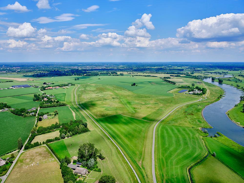 Nederland, Gelderland, Gemeente Brummen, 21–06-2020; rivier de IJssel, dijkverlegging Cortenoever. De Brummense Bandijk (winterdijk) is verlaagd en heeft een uitstroom-openingen gekregen en er is een nieuwe dijk aangelegd, meer landinwaarts. Het gebied tussen oude en nieuwe dijk is meestroom-gebied in geval van hoog water. Een gemaal <br /> Shifting the Cortenoever dike. A new (secondary) dike has been build, more landinward, the existing dike has been reduced in height to the to create exit opening. The area between old and new dike will flood in case of high water.<br /> <br /> luchtfoto (toeslag op standaard tarieven);<br /> aerial photo (additional fee required)<br /> copyright © 2020 foto/photo Siebe Swart