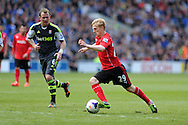 Cardiff city's Mats Daehli makes a break. Barclays Premier league match, Cardiff city  v Stoke city at the Cardiff city stadium in Cardiff, South Wales on Saturday 19th April 2014. pic by Andrew Orchard, Andrew Orchard sports photography,