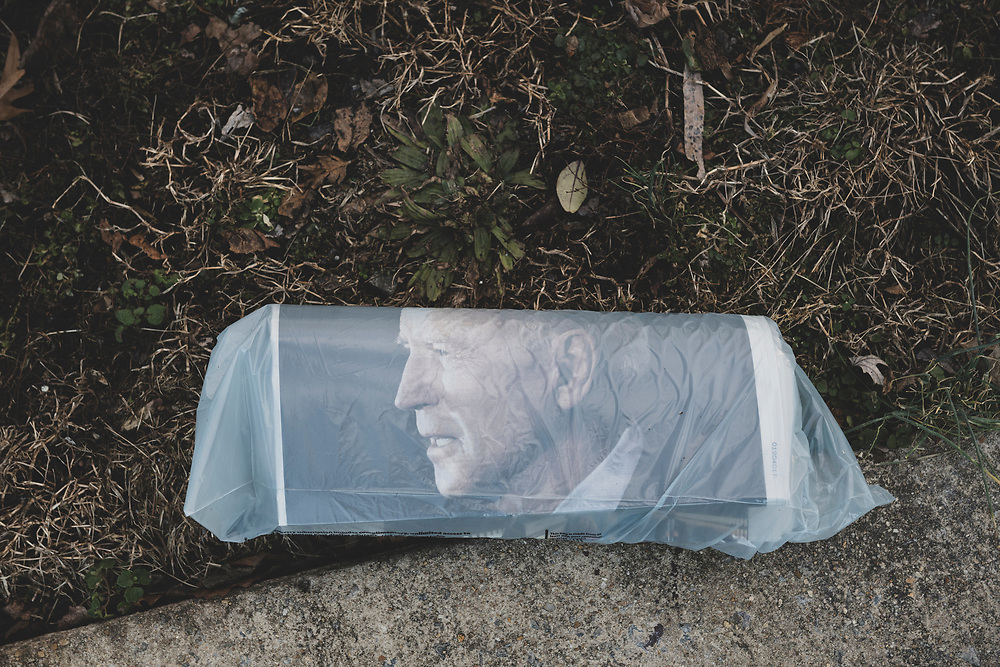 Alexandria, Virginia, USA - January 20, 2021: On the morning of the 59th presidential inauguration, a copy of the Washington Post lies on the edge of a driveway in the D.C. suburbs. Joseph Biden is on the cover.