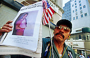 NEW YORK, NY: A man holds up a poster on Broadway in lower Manhattan while he looks for a family friend who had been a janitor in the World Trade Center after the terrorist attack on the WTC, Sept. 22, 2001. Almost 3,000 people were killed when terrorists crashed two airliners into the towers on Sept. 11, 2001. The site has turned into a macabre tourist attraction and the crowds are creating problems for law enforcement and recovery workers. PHOTO BY JACK KURTZ