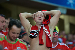 LILLE, FRANCE - Friday, July 1, 2016: A Wales supporter holds his head in his hands in disbelief as he celebrates the 3-1 victory against Belgium at full time after the UEFA Euro 2016 Championship Quarter-Final match at the Stade Pierre Mauroy. (Pic by Paul Greenwood/Propaganda)
