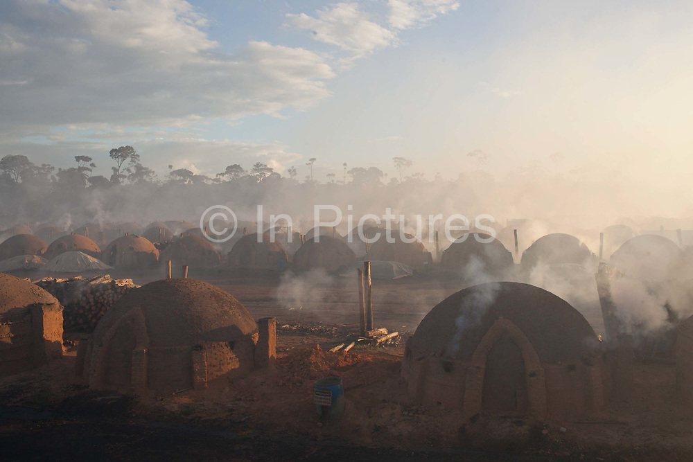 Charcoal buring site, Maranhao, northeastern Brazil, eucalyptus trees are grown primarily to fire the burners situated on the same site. Reports of poor working conditions and bonded labour have been reported at some of the sites.