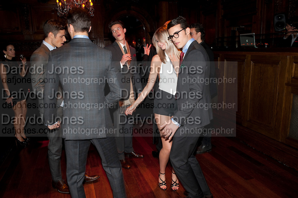 ALEX CATTELL ( GIRL DANCING) WITH MEN IN SUITS,  DSquared2 Launch of their Classic collection. Tramp. Jermyn St. London. 29 June 2011. <br /> <br />  , -DO NOT ARCHIVE-© Copyright Photograph by Dafydd Jones. 248 Clapham Rd. London SW9 0PZ. Tel 0207 820 0771. www.dafjones.com.
