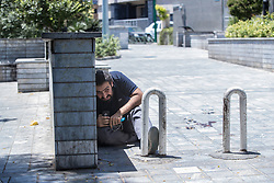 Jun 7, 2017 - Tehran, Iran - A man takes cover near the parliament building after gunmen opened fire at Iran's parliament and the shrine of Ayatollah Khomeini in the capital Tehran, Iran. The terrorist militia ISIS claimed responsibility for the attacks. (Credit Image: ? Erfan Kouchari/Tasnim/IranImages via ZUMA Wire)