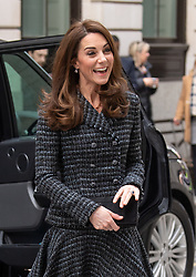 The Duchess of Cambridge, wearing a chic tweed suit and black tights, attends a 'mental health in education' conference at Mercers Hall in London on February 13, 2019.