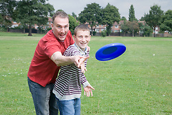 Father and son throwing a Frisbee,