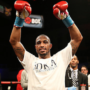 J'Leon Love (red trunks) celebrates after defeating Vladine Biosse during Showtime Televisions ShoBox:The Next Generation boxing match at the Event Center at Turning Stone Resort Casino on Friday, February 28, 2014 in Verona, New York.  (AP Photo/Alex Menendez)
