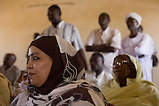 Before continuing to the first-ever international Conference on Womens' Challenge in Darfur, Amira Elfadil, Secretary General of the National Council of Child Welfare listens to speeches inside the 4 sq km camp Abo Shouk refugee camp, which is (disputedly) home to 38,000 displaced persons, on the outskirts of Al Fasher, Sudan.