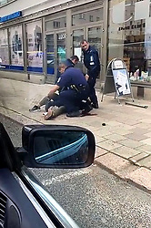 (170818) -- TURKU (FINLAND), Aug. 18, 2017 (Xinhua) -- Police officers detain the attacker who stabbed people in Turku, southwestern Finland, on Aug. 18, 2017. Several people were stabbed in downtown Turku, southwestern Finland on Friday, when more than one man mounted the attacks simultaneously. At least two died and eight others were injured, according to local media. (Xinhua/Zhilwan Pirkhezri) (Photo by Xinhua/Sipa USA)