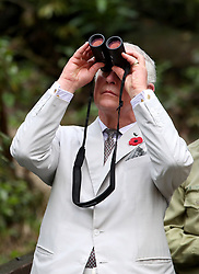 The Prince of Wales using binoculars to look for orangutans during a visit to the Sarawak Semenggoh Wildlife Rehabilitation Centre in Kuching, Malaysia.