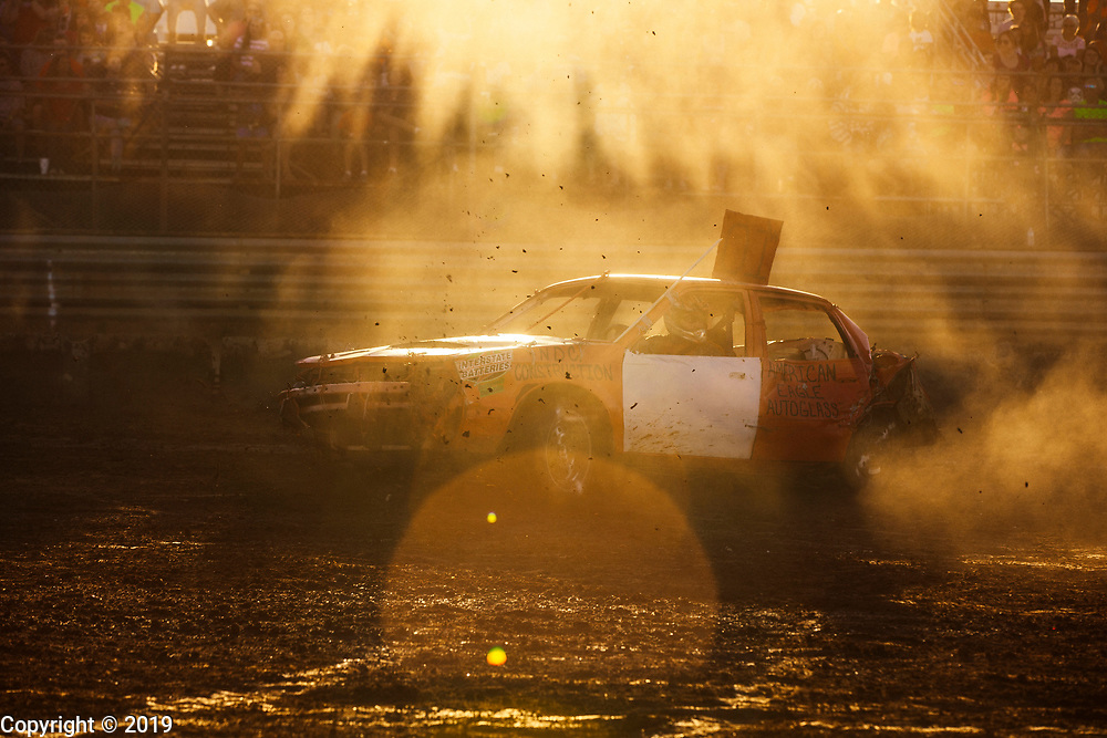 A car stirs up dust while making circles as its driver avoids a collision during the Demolition Derby at the Monroe County Fair, July 7, 2018 in Bloomington, Ind.