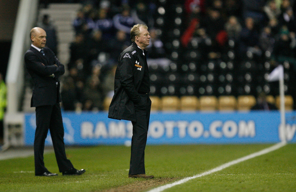 Wigan Athletic manager Uwe Rosler (L) and Derby County manager Steve McClaren<br /> <br /> Photo by Jack Phillips/CameraSport<br /> <br /> Football - The Football League Sky Bet Championship - Derby County v Wigan Athletic - Wednesday 1st January 2014 - The iPro Stadium - Pride Park - Derby <br /> <br /> <br /> <br /> © CameraSport - 43 Linden Ave. Countesthorpe. Leicester. England. LE8 5PG - Tel: +44 (0) 116 277 4147 - admin@camerasport.com - www.camerasport.com