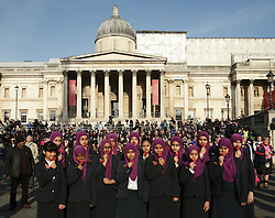 Two minutes' silence is observed by girls during an event in London's Trafalgar Square to mark Armistice Day.