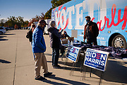 28 OCTOBER 2020 - DES MOINES, IOWA: People line up to get campaign materials for Biden/Harris and Cindy Axne at a Get Out the Vote event at Drake University. Rep. Axne hosted a Get Out the Vote event at Drake University Wednesday morning. Axne, a Democrat, represents Iowa's 3rd District, from the southwest corner of the state up through the Des Moines area. She is in a tight race for reelection with David Young, the Republican she defeated in 2018.      PHOTO BY JACK KURTZ