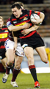 Canterbury wing Caleb Ralph gets tackled during the Air New Zealand Cup week 4 Ranfurly Shield match between Canterbury and Southland on Friday August 18, 2006 at Jade Stadium in Christchurch, New Zealand. Canterbury won the game 24-7. Photo: Jim Helsel/Photosport