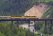 Alaska. Alaska Railroad southbound from the Denali Station, crossing over the Hines Creek Trestle, heading toward Anchorage.