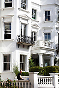 White residences on Kensington Park Road in Notting Hill, West London. Made famous from the movie of the same name.