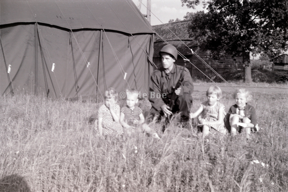 soldier on an exercise posing with children 1960s