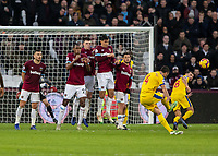 Football - 2018 / 2019 Premier League - West Ham United vs. Crystal Palace<br /> <br /> Luka Milivojevic (Crystal Palace) strikes his free kick around the West Ham wall at the London Stadium<br /> <br /> COLORSPORT/DANIEL BEARHAM