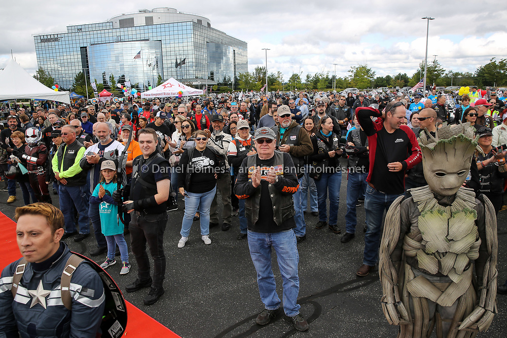 (8/25/19, FRAMINGHAM, MA) Riders gather for a safety meeting during the New England Ride for Kids hosted by the Pediatric Brain Tumor Foundation at Bose Corporation in Framingham on Sunday. [Daily News and Wicked Local Photo/Dan Holmes]