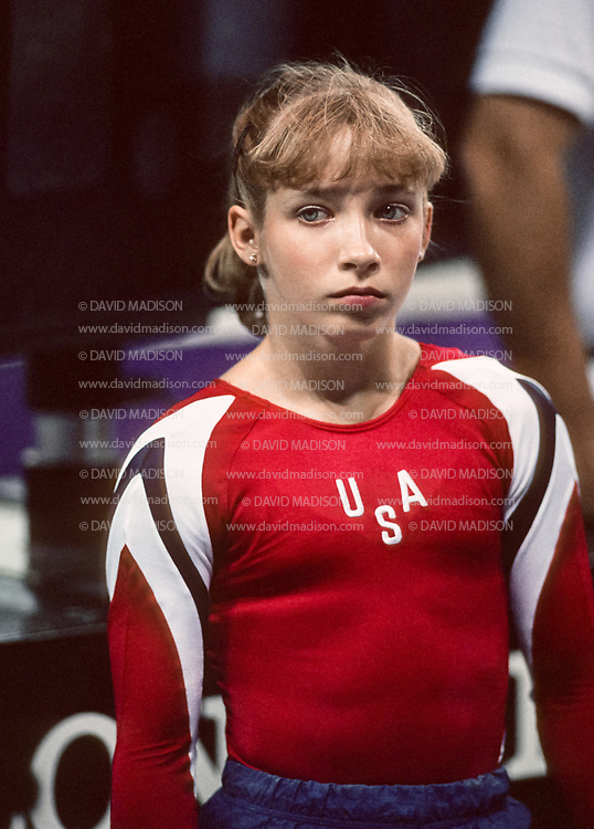 SEATTLE - JULY 1990:  Kim Zmeskal of the United States waits between events during the gymnastics competition of the 1990 Goodwill Games held from July 20 - August 5, 1990.  The gymnastics venue was the Tacoma Dome in Tacoma, Washington.  (Photo by David Madison/Getty Images)