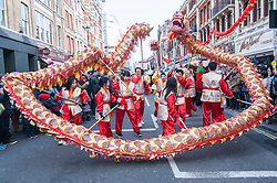 © Licensed to London News Pictures. 22/02/2015. Chinatown, London, UK. The dragon weaves its way round at the front of the annual Chinese New Year Parade which takes place around Chinatown to celebrate the Year of the Sheep. Photo credit : Stephen Chung/LNP